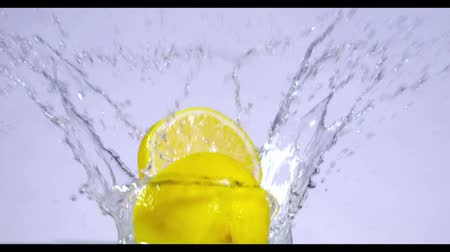 cytryna : slow motion of falling Lemons into water