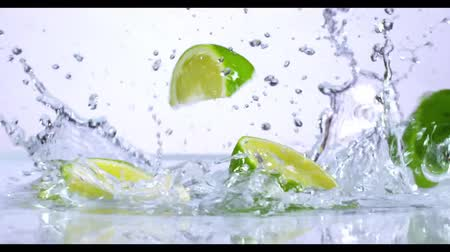 slow motion of falling lime into water