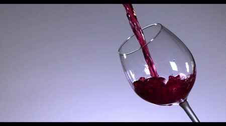 doldurmak : Slow motion of pouring red wine from bottle into goblet