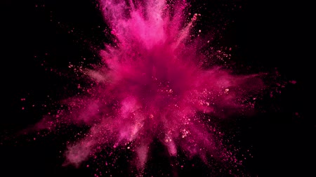 Super slow motion of colored powder explosion isolated on black background. Filmed on high speed cinema camera, 1000fps.