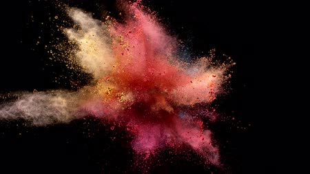 rotaları : Super slow motion of colored powder explosion isolated on black background. Filmed on high speed cinema camera, 1000fps.