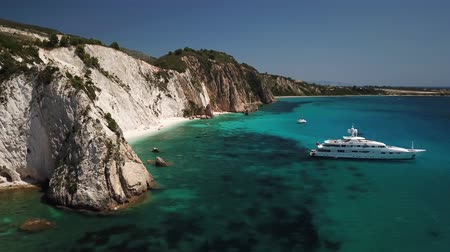 Řecko : Aerial view of idyllic sandy beach with luxury yacht, Kefalonia, Greece. Summer relaxation, travel and nature motive