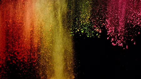 mix colors : Super slow motion of coloured powder falling on black background. Filmed on high speed cinema camera, 1000 fps. Stock Footage