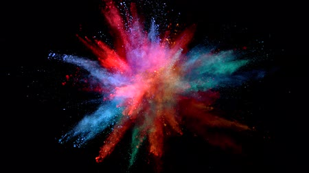 Super slow motion of coloured powder explosion isolated on black background. Filmed on high speed cinema camera, 1000fps. 影像素材