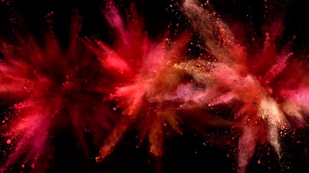 puder : Super slow motion of coloured powder explosion isolated on black background. Filmed on high speed cinema camera, 1000fps. Wideo