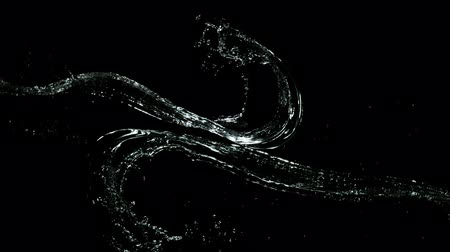 Super slow motion splashing water isolated on black background. Filmed on very high speed camera, 1000 fps. 影像素材