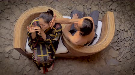 modern tasarım : Overhead shot of a shirtless Mexican man touching a Japanese butoh dancers face to court her in a traditional dance while sitting in a serpentine chair opposite of one another.