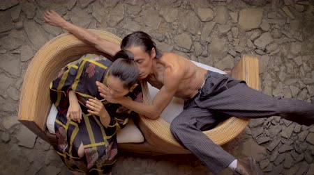 enstrüman : Strange awkward displays of affection between two mixed ethnic butoh dancers, a Mexican man and a Japanese woman in a geisha costume. Stok Video