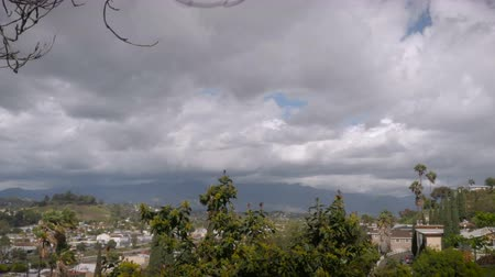okładka : Timelapse of east Los Angeles, California facing the San Gabriel Mountains with heavy cloud movement Wideo