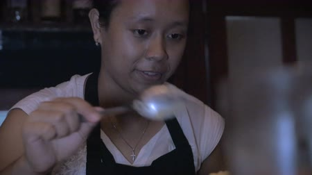 obesidade : A pastry chef prepares a dessert and smiles in a busy restaurant