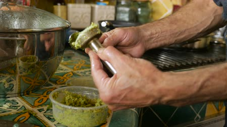 żyd : Close up of a man spooning homemade falafel into a pot Wideo
