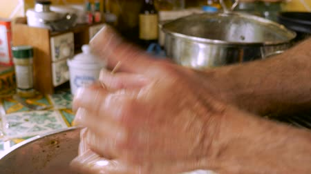 pascha : Close up of a man making matzah balls or meat balls with his hands covered in oil before he places it in a pot for cooking. Wideo