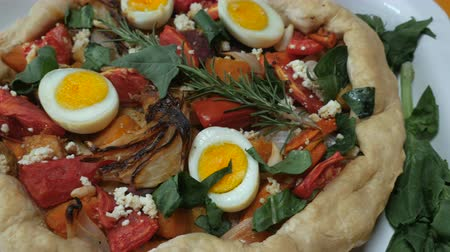 specialties : Healthy, home made vegetable torte with hard boiled eggs, cheese, tomatoes, onions, spinach, and rosemary continuous dolly shot Stock Footage