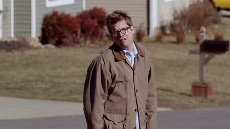 kicked : A depressed man walks away in suburbia looking disheveled and unkempt. Stock Footage