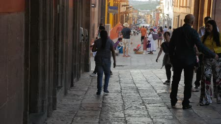 pedestrian only : SAN MIGUEL DE ALLENDE, MEXICO - CIRCA MAY 2016 - Tourists walk around the closed streets of San Miguel de Allende in slow motion Stock Footage