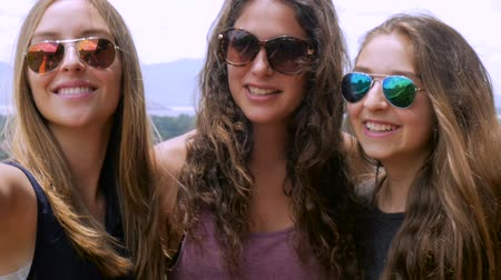 selfie girl : Three beautiful young teenage girls smiling and taking selfies in slowmo in the summer