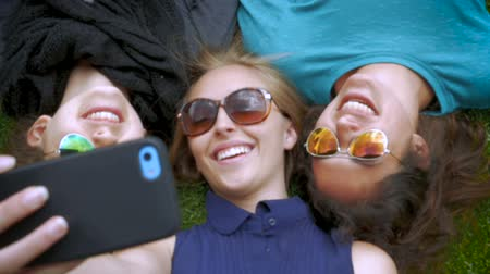 selfie girl : Three best friends take a selfie while lying next to each other in slow motion