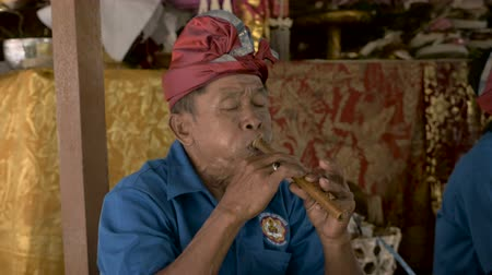 flutist : Balinese flute player performs during a Hindu ceremony in Bali