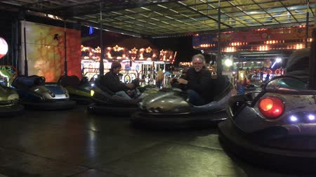 targi : PATZCUARO , MEXICO - CIRCA NOVEMBER 2016 - Adult men having fun in bumper cars at a county or state fair. Wideo