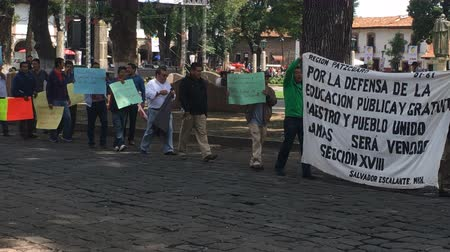 picketing : PATZCUARO , MEXICO - CIRCA JULY 2016 - Teachers protesting peacefully with signs in Spanish.