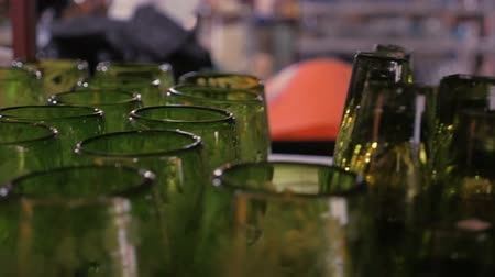 specialties : Shelves of etched artisan green glasses in a glass factory