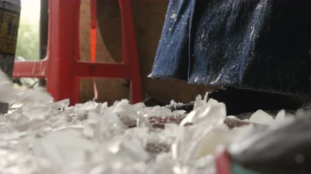 cera : Wax chips scrapings waste fall and collect on floor in factory manufacture plant Stock Footage