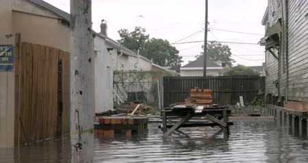 levee : NEW ORLEANS, USA - JULY 22, 2017 - POV driving through flooded streets with homes in a neighborhood under water from a tropical depression Stock Footage