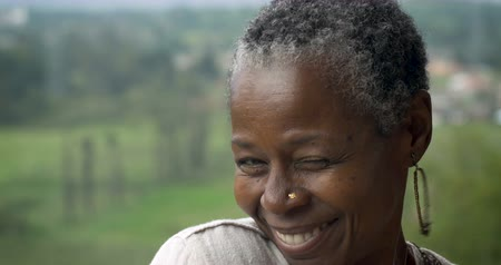 pain free : Beautiful African American woman in her 60s flirting and being silly rolling her shoulder and blowing kisses Stock Footage