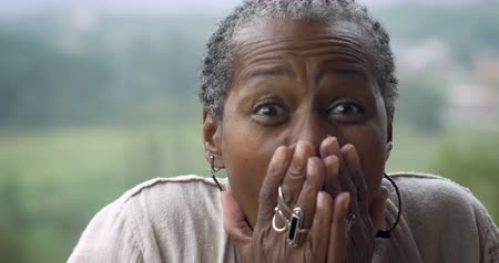 pain free : Happy surprised senior African American woman in 60s expressing she won something Stock Footage