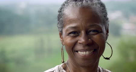 pain free : Portrait of a stunning African American woman in her 60s smiling at the camera outside