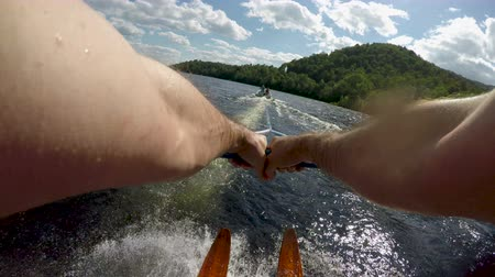 bezmotorové létání : POV of a strong athletic man water skiing on a beautiful lake with vintage wooden water skis Dostupné videozáznamy
