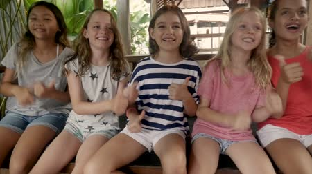 慶典 : Diverse multi racial Asian and Caucasian group of six young happy smiling girls chair dancing and having fun together 影像素材