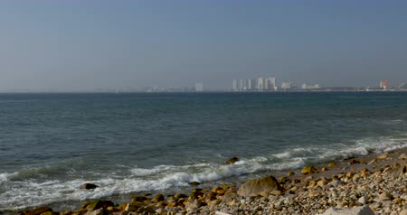 mexico city : Tilt down of hotels and condos on the coastline of a ocean beach during the day Stock Footage
