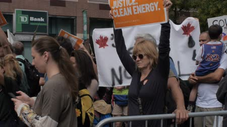 ralli : NEW YORK CITY, UNITED STATES - SEPTEMBER 21, 2014 - People holding signs at a protest for clean energy and green jobs at the Peoples Climate March, a large-scale activist event to advocate global action against climate change.