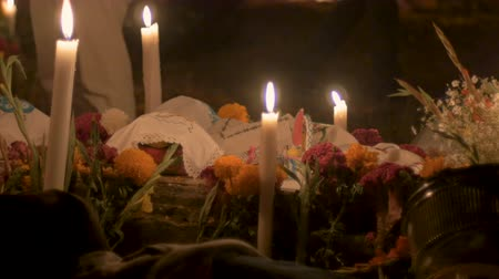 muertos : Baskets with food offerings, candles, and marigold flowers during day of the dead in Mexico Stock Footage