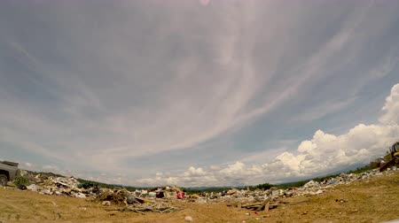 yükleyici : ALEXANDER, NC, UNITED STATES - CIRCA MAY 2017 - POV approaching a landfill dump with bulldozer pushing trash - wide angle