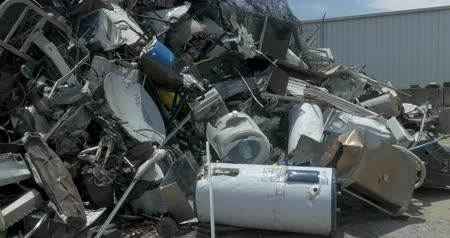 wasteful : ALEXANDER, NC, UNITED STATES - CIRCA MAY 2017 - Large pile of scrap metal and broken appliances in a junkyard, landfill, or recycling center