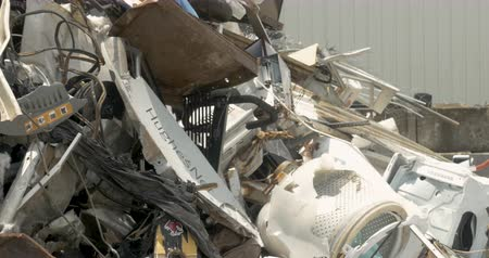 ALEXANDER, NC, UNITED STATES - CIRCA MAY 2017 - Close up of a bunch of recycled appliances and scrap metal at a recycling center, garbage dump, landfill, or transfer station - dolly shot