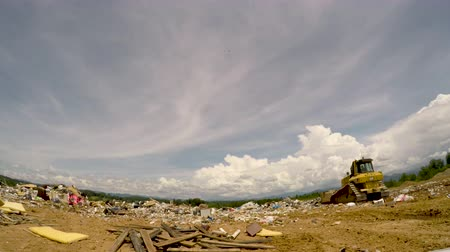 ALEXANDER, NC, UNITED STATES - CIRCA MAY 2017 - Caterpillar bulldozer pushing a pile of trash in a landfill junkyard dump