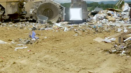 ALEXANDER, NC, UNITED STATES - CIRCA MAY 2017 - Caterpillar bulldozer landfill compactor moving trash at a landfill