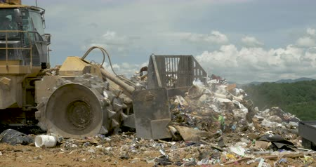 ALEXANDER, NC, UNITED STATES - CIRCA MAY 2017 - Close up of a Caterpillar bulldozer pushing trash in a landfill