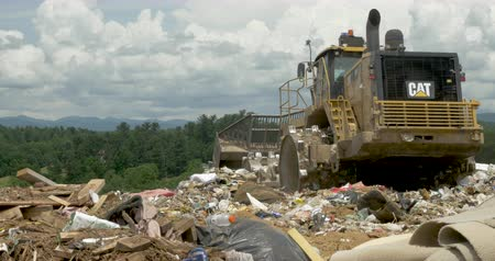 geri dönüşümlü : ALEXANDER, NC, UNITED STATES - CIRCA MAY 2017 - Caterpillar bulldozer eliminating trash at a landfill in Western North Carolina