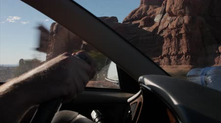 otopark : A man driving a car in arches national park