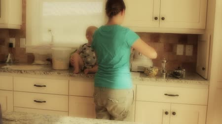 frigorífico : a mother and baby cooking in the kitchen Stock Footage