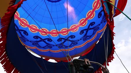 propane : A pilot raises his hot air balloon at a hot air balloon festival