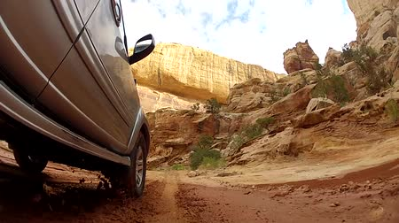 cauda : an suv driving through capitol reef national park in southern utah