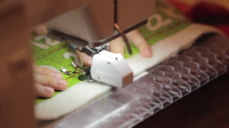 závit : a woman sewing a christmas advent calendar