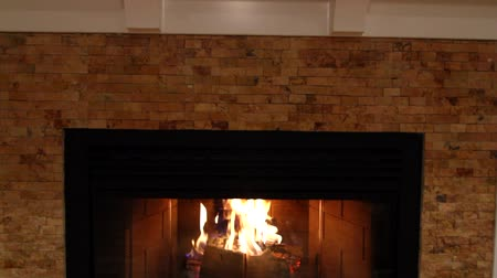 cozy : a jib shot of a cozy fireplace and mantle Stock Footage