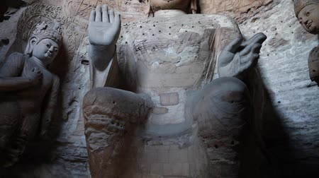 the yungang grottoes in datong where buddhist sculptures can be found in caves.  now one of the unesco world heritage sites. Стоковые видеозаписи