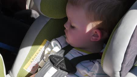 přezka : A little boy sleeping in his car seat